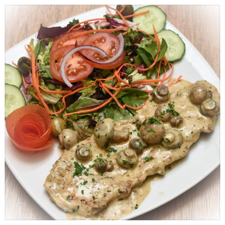 Chicken with mushrooms, cream sauce and salad